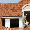 Marvin Rivera walks across tiles as he works on clay tile roof of house being built on the corner of Guilford Lane and Pennsylvania in Nichols Hills Monday afternoon, Oct. 1, 2007. By Jim Beckel, The Oklahoman.