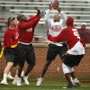 Cream Team member Danny Wilson goes up for a pass defended by Brian Bosworth, Rufus Alexander and Larry Birdine during the OU Legends flag football game for the University of Oklahoma (OU) Sooners at Gaylord Family/Oklahoma Memorial Stadium on Saturday, April 17, 2010, in Norman, Okla. Photo by Steve Sisney, The Oklahoman