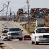 Missouri Gov. Jay Nixon tours storm damage in a motorcade along Highway 76 in Branson, Mo., Wednesday, Feb. 29, 2012. An apparent tornado hopscotched through the city\'s main tourist district overnight, causing damage for miles. (AP Photo/Mark Schiefelbein) ORG XMIT: MOMS120