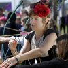 Elfan archery instructor Brandi Adair, Gainsville, Florida, helps Eden Rodriguez with her bow during the Medieval Fair at Reaves Park on Friday, April 5, 2013 in Norman, Okla. Photo by Steve Sisney, The Oklahoman