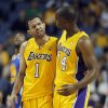 Los Angeles Lakers forward Marcus Landry, right, congratulates Lakers guard Jordan Farmar, left, after making a shot and collecting a foul against the Golden State Warriors in the fourth quarter during an NBA basketball preseason game Saturday, Oct. 5, 2013, in Ontario, Calif. Lakers won the game 104-95. (AP Photo/Alex Gallardo)