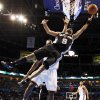 San Antonio\'s Tony Parker (9) takes a shot in front of Oklahoma City\'s Serge Ibaka (9) during the NBA basketball game between the Oklahoma City Thunder and the San Antonio Spurs at Chesapeake Energy Arena in Oklahoma City, Friday, March 16, 2012. Photo by Nate Billings, The Oklahoman