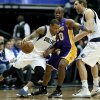 Dallas Mavericks\' Monta Ellis (11) drives through Los Angeles Lakers\' Jodie Meeks (20) as Dirk Nowitzki, right, sets the pick in the first half of an NBA basketball game, Tuesday, Jan. 7, 2014, in Dallas. (AP Photo/Tony Gutierrez)
