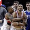 Portland Trail Blazers guard Damian Lillard, left, hugs teammate Nicolas Batum after winning an NBA basketball game against the Los Angeles Clippers in Portland, Ore., Saturday, Jan. 26, 2013. Both players scored 20 points each as the Trail Blazers won 101-100. (AP Photo/Don Ryan)