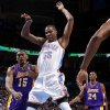 Kevin Durant (35) loses control of the ball between Metta World Peace (15) and Kobe Bryant (24) during an NBA basketball game between the Oklahoma City Thunder and the Los Angeles Lakers at Chesapeake Energy Arena in Oklahoma City, Thursday, Feb. 23, 2012. Photo by Bryan Terry, The Oklahoman