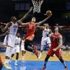 Houston\'s Chandler Parsons (25) moves to the hoop between Oklahoma City\'s Kevin Durant (35), Thabo Sefolosha (2) and Houston\'s Omer Asik (3) during Game 2 in the first round of the NBA playoffs between the Oklahoma City Thunder and the Houston Rockets at Chesapeake Energy Arena in Oklahoma City, Wednesday, April 24, 2013. Oklahoma City won, 105-102. Photo by Nate Billings, The Oklahoman