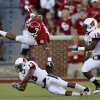 Oklahoma\'s Dominique Whaley (8) leaps over Ball State\'s Armand Dehaney (13) as Aaron Morris (15) trails during the college football game between the University of Oklahoma Sooners (OU) and the Ball State Cardinals at Gaylord Family-Memorial Stadium on Saturday, Oct. 01, 2011, in Norman, Okla. Oklahoma won 62-6. Photo by Bryan Terry, The Oklahoman