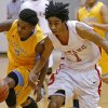 Carl Albert\'s Malik Barnett, right, and Putnam CIty West\'s Omega Hrris go for the ball during their high school basketball game at Carl Albert in Midwest City, Okla., Friday, Jan. 25, 2013. Photo by Bryan Terry, The Oklahoman