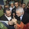 Gaza\'s Hamas Prime Minister Ismail Haniyeh, right, and Egyptian Prime Minister Hesham Kandil, left, hold the body of a Palestinian boy they claim was killed in an Israeli strike on Gaza City, as they show the body to the media at Shifa hospital in Gaza City, Friday, Nov. 16, 2012. Neighbors said the boy was killed in a blast around 8:30 a.m. Friday, around the time Kandil was entering the territory. Israel, which ordinarily confirms strikes, vociferously denied carrying out any form of attack in the area since the previous night. (AP Photo/Mahmud Hams, Pool)