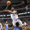 Dallas\' Ian Mahinmi (28) shoots over Oklahoma City\'s James Harden (13) during the pre season NBA game between the Dallas Mavericks and the Oklahoma City Thunder at the American Airlines Center in Dallas, Sunday, Dec. 18, 2011. Photo by Sarah Phipps, The Oklahoman