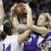 Okarche\'s Kanadey Grellner and Chattanooga\'s Holly Garza fight for a rebound during the Class A girl\'s semi final game between Chattanooga and Okarche at the State Fair Arena in Oklahoma City, Friday, March 2, 2012. Photo by Sarah Phipps, The Oklahoman