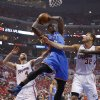 Oklahoma City\'s Serge Ibaka (9) gets a rebound as Los Angeles\' J.J. Redick (4) and Blake Griffin (32) defend during Game 6 of the Western Conference semifinals in the NBA playoffs between the Oklahoma City Thunder and the Los Angeles Clippers at the Staples Center in Los Angeles, Thursday, May 15, 2014. Photo by Nate Billings, The Oklahoman