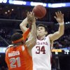 Oklahoma\'s Cade Davis (34) puts up a shot over Syracuse\'s Arinze Onuaku (21) during the first half of the NCAA Men\'s Basketball Regional at the FedEx Forum on Friday, March 27, 2009, in Memphis, Tenn. PHOTO BY CHRIS LANDSBERGER, THE OKLAHOMAN