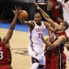 Oklahoma City\'s Kevin Durant (35) passes the ball between Miami\'s LeBron James, left, and Miami\'s Shane Battier during Game 1 of the NBA Finals between the Oklahoma City Thunder and the Miami Heat at Chesapeake Energy Arena in Oklahoma City, Tuesday, June 12, 2012. Photo by Nate Billings, The Oklahoman