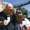 Fans Dan McKenzie, of Ottawa, Ontario, and Jennifer Sayler of Haverhill, Mass., wear fake beards and show their tickets outside Fenway Park in Boston, Wednesday, Sept. 18, 2013, prior to a baseball game between the Boston Red Sox and the Baltimore Orioles. The Red Sox sold a number of tickets for the game for one dollar to fans who sported beards resembling those of some of the Red Sox players. (AP Photo/Elise Amendola)