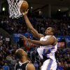 Oklahoma City\'s Serge Ibaka (9) goes to the basket over Sacramento\'s Chuck Hayes (42) during an NBA basketball game between the Oklahoma City Thunder and the Sacramento Kings at Chesapeake Energy Arena in Oklahoma City, Friday, Dec. 14, 2012. Photo by Bryan Terry, The Oklahoman