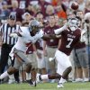 Texas A&M\'s Uzoma Nwachukwu makes a catch in front of Oklahoma State\'s Justin Gilbert in the second half of their game Saturday in College Station, Texas. Photo by Sarah Phipps, The Oklahoman