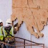 Workers make finishing touches to a buffalo design on an Interstate 235 ramp. Photo by Jim Beckel, The Oklahoman archives