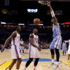 Denver\'s Nene (31) dunks the ball beside Oklahoma City\'s Kendrick Perkins (5) and Kevin Durant (35) during the NBA basketball game between the Denver Nuggets and the Oklahoma City Thunder in the first round of the NBA playoffs at the Oklahoma City Arena, Sunday, April 17, 2011. Photo by Bryan Terry, The Oklahoman