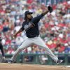 Atlanta Braves starting pitcher Ervin Santana throws against the Philadelphia Phillies in the first inning of the first game of a baseball double-header Saturday, June 28, 2014, in Philadelphia. (AP Photo/H. Rumph Jr)