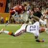 OU\'s Jermaine Gresham leaps over Florida\'s Major Wright during the first half of the BCS National Championship college football game between the University of Oklahoma Sooners (OU) and the University of Florida Gators (UF) on Thursday, Jan. 8, 2009, at Dolphin Stadium in Miami Gardens, Fla. PHOTO BY BRYAN TERRY, THE OKLAHOMAN