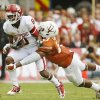 UT\'s Adrian Phillips (17) stops OU\'s Jalen Saunders (8) in the first half during the Red River Rivalry college football game between the University of Oklahoma Sooners and the University of Texas Longhorns at the Cotton Bowl Stadium in Dallas, Saturday, Oct. 12, 2013. Photo by Nate Billings, The Oklahoman