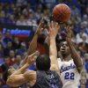 Photo - Kansas guard Andrew Wiggins (22) shoots over TCU forward Amric Fields (4) and guard Kyan Anderson, left, during the first half of an NCAA college basketball game in Lawrence, Kan., Saturday, Feb. 15, 2014. (AP Photo/Orlin Wagner)