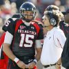 Texas Tech head coach Mike Leach talks with Texas Tech\'s Taylor Potts during the college football game between the University of Oklahoma Sooners (OU) and Texas Tech University Red Raiders (TTU ) at Jones AT&T Stadium in Lubbock Okla., Saturday, Nov. 21, 2009. Photo by Bryan Terry, The Oklahoman