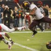 Texas Tech\'s Derreck Edwards (19) flips into the end zone for a touchdown ahead of Minnesota\'s Antonio Johnson (11) during the first quarter of the Meineke Car Care Bowl NCAA college football game, Friday, Dec. 28, 2012, in Houston. (AP Photo/Dave Einsel)