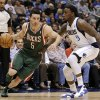 Milwaukee Bucks\' J.J. Redick (5) attempts to get past Dallas Mavericks\' Jae Crowder (9) on a drive to the basket in the first half of an NBA basketball game Tuesday, Feb. 26, 2013, in Dallas. (AP Photo/Tony Gutierrez)