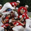 Hilldale players jump onto each other near the pitcher\'s mound after winning the Class 4A state high school baseball championship game at Shawnee High School\'s Memorial Park. on Saturday,, May 12, 2012. At the bottom of the pile are the team\'s winning pitcher Hunter Harrison and their catcher Jarrard Poteete. The Hilldale Hornets defeated the Berryhill Chiefs, 2-1. Photo by Jim Beckel, The Oklahoman