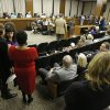 Photo - Speakers line up to speak in opposition of a bill that would remove funding for abortions during a meeting of the Senate Health Education and Welfare committee at the Capitol Thursday, Jan. 17, 2013 in Richmond, Va. The committee killed the bill.  (AP Photo/Steve Helber)