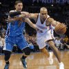 Oklahoma City Thunder\'s Derek Fisher (6) battles for the ball with New Orleans Hornets\' Austin Rivers (25) during the NBA basketball game between the Oklahoma City Thunder and the New Orleans Hornets at the Chesapeake Energy Arena on Wednesday, Feb. 27, 2013, in Oklahoma City, Okla. Photo by Chris Landsberger, The Oklahoman
