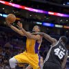 Los Angeles Lakers guard Darius Morris is fouled by San Antonio Spurs center DeJuan Blair during the second half in Game 3 of a first-round NBA basketball playoff series, Friday, April 26, 2013, in Los Angeles. The Spurs won 120-89. (AP Photo/Mark J. Terrill)