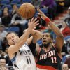 Minnesota Timberwolves\' J.J. Barea (11) attempts to steal the ball from Portland Trail Blazers\' LaMarcus Aldridge (12) during the third quarter of an NBA basketball game Monday, Feb. 4, 2013, in Minneapolis. The Trail Blazers won 100-98. (AP Photo/Hannah Foslien)