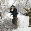 Purcell firefighter Jason Benefiel cuts limbs obstructing traffic on Friday, Jan. 29, 2010, in Purcell, Okla. after a winter storm. Photo by Steve Sisney, The Oklahoman