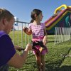 Abigail Suttle is secured in a harness by Micheal Blair before she climbs on the rockwall during the Oklahoma Regatta Festival at the Oklahoma River on Saturday, Oct. 1, 2011, in Oklahoma City, Okla. Photo by Chris Landsberger, The Oklahoman