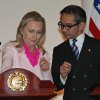 Photo -   US Secretary of State Hillary Rodham Clinton, left, chats with Indonesian Foreign Minister Marty Natalegawa before the start of a joint press conference after their meeting in Jakarta, Indonesia, Monday, Sept. 3, 2012. (AP Photo/Dita Alangkara)