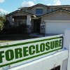 A foreclosure sign sits outside a home for sale in Phoenix earlier this year. Arizona is one of the states with the highest foreclosure rates in the country. AP ARCHIVE