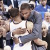 Kevin Durant, right, hugs Russell Westbrook after Westbrook finished with a triple-double in Oklahoma City's 96-87 win over Dallas on Monday. The earliest Durant could return is this weekend. Photo BY NATE BILLINGS, THE OKLAHOMAN