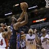 Charlotte Bobcats\' Al Jefferson (25) shoots in front of Miami Heat\'s Ray Allen (34), Chris Andersen (11) and Chris Bosh (1) during the second half in Game 1 of an opening-round NBA basketball playoff series, Sunday, April 20, 2014, in Miami. The Heat defeated the Bobcats 99-88. (AP Photo/Lynne Sladky)