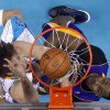 New Orleans Hornets center Robin Lopez, left, goes to the basket against Los Angeles Lakers center Dwight Howard during the first half of an NBA basketball game in New Orleans, Wednesday, March 6, 2013. (AP Photo/Gerald Herbert)