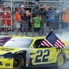 Photo - Brad Keselowski does a burnout as he celebrates after winning the NASCAR Nationwide Series auto race at New Hampshire Motor Speedway Saturday, July 12, 2014, in Loudon, N.H. (AP Photo/Jim Cole)