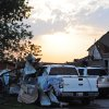 A piece of sheet metal is wrapped around a Ford F-150 truck at the house of Ida Clark after a tornado tore through Carney, Okla. on May 19, 2013. KT King/For the Oklahoman