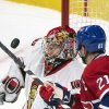 Photo - Ottawa Senators goaltender Craig Anderson, left, makes a save against Montreal Canadiens' Brian Gionta during the second period of an NHL hockey game in Montreal, Saturday, Jan. 4, 2014. (AP Photo/The Canadian Press, Graham Hughes