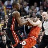 Chicago Bulls guard Kirk Hinrich, right, and Miami Heat center Chris Bosh wrestle for a rebound during the second half of an NBA basketball game in Chicago on Wednesday, March 27, 2013. The Bulls won 101-97, ending the Heat\'s 27-game winning streak. (AP Photo/Nam Y. Huh)