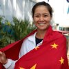 Photo - In this photo released by Tennis Australia,  Li Na of China poses with a Chinese flag at the Australian Open tennis championship in Melbourne, Australia, Friday, Jan. 24, 2014.  Li faces Dominika Cibulkova of Slovakia in the women's singles final Saturday. (AP Photo/Tennis Australia, Fiona Hamilton)