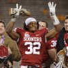 Oklahoma\'s Jamell Fleming (32) reacts after being named the defensive player of the game following Oklahoma\'s win in the Insight Bowl college football game between the University of Oklahoma (OU) Sooners and the Iowa Hawkeyes at Sun Devil Stadium in Tempe, Ariz., Friday, Dec. 30, 2011. Photo by Bryan Terry, The Oklahoman