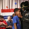 Staff Sergeant Harold Williams wipes tears from his son\'s face after he surprised Adrian, a fifth grade student during a patriotic-themed Veteran\'s Day assembly Friday morning, Nov. 9, 2012, at Schwartz Elementary School, when he walked onto the stage while his son and classmates were reciting the preamble of the U.S. Constitution. The elder Williams arrived at the school this morning and had been hidden off stage until his son\'s class gathered on the stage. Father and son embraced for nearly two minutes in front of a large red, white and blue backdrop. Adrian wiped away tears and tears also rolled down the cheeks of Sgt. Williams. Harold has been stationed in Germany with the U.S. Army and recently returned there from duty in Iraq. Photo by Jim Beckel, The Oklahoman