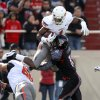 Texas Tech\'s Cody Davis (16) pushes Oklahoma State\'s Joseph Randle (1) out of bounds as Lane Taylor (68) blocks during a college football game between Texas Tech University (TTU) and Oklahoma State University (OSU) at Jones AT&T Stadium in Lubbock, Texas, Saturday, Nov. 12, 2011. Photo by Sarah Phipps, The Oklahoman ORG XMIT: KOD